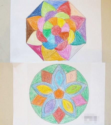미술치료 활동으로 만다라 도안을 색칠하고 계신 어르신들의 모습.