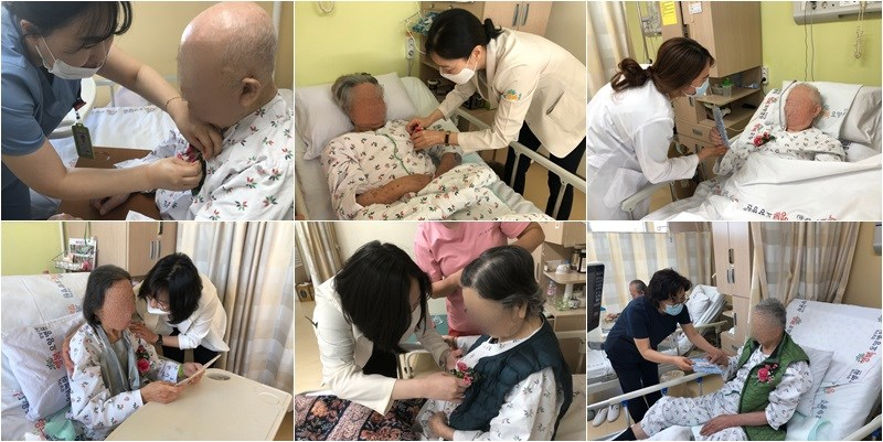 5월 8일 어버이날, 행복병원 직원들이 환자분들께 카네이션을 달아드리고 있는 사진